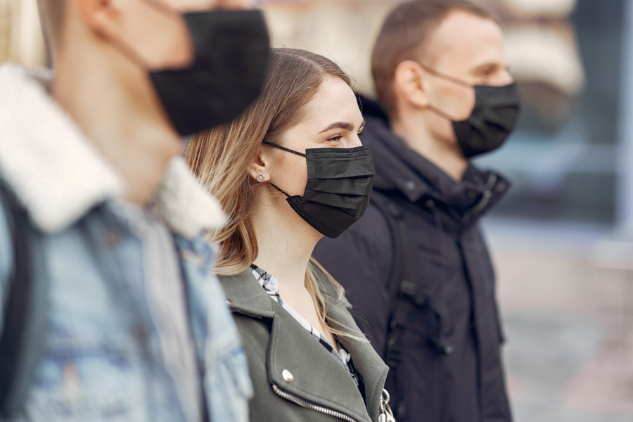 people masks stands street